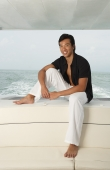 Man on yacht, smiling at camera - Yukmin