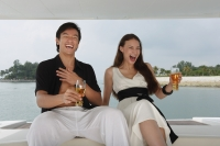 Couple on yacht, laughing - Yukmin
