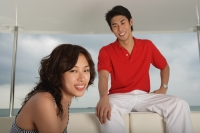 Couple on yacht, smiling at camera - Yukmin