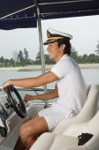 Man steering yacht - Yukmin