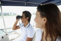 Young couple on yacht, looking into distance - Yukmin