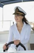 Young woman steering yacht - Yukmin