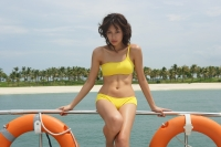 Young woman on yacht, looking at camera - Yukmin