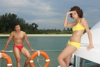 Young couple on yacht, woman looking at camera - Yukmin
