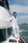 Young man on yacht, looking into distance - Yukmin