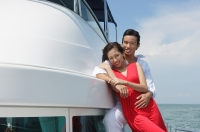 Young couple on yacht, smiling at camera - Yukmin