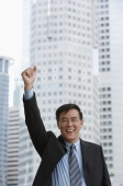 Businessman raising his arm and making a fist - Yukmin