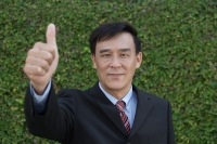 Businessman giving his thumb up - Yukmin