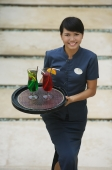 Balinese waitress carrying cocktails - Cedric Lim