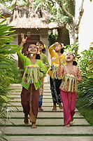 Balinese girls throwing flowers - Cedric Lim