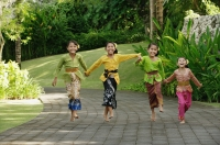 Balinese girls laughing and running - Cedric Lim
