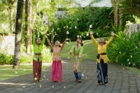 Balinese girls laughing and throwing flowers - Cedric Lim