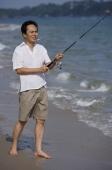 Man fishing at the beach - Alex Mares-Manton