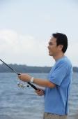 Man fishing in the sea - Alex Mares-Manton
