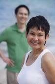 Mature couple at the beach, smiling at camera - Alex Mares-Manton