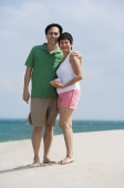 Mature couple at the beach smiling at camera - Alex Mares-Manton