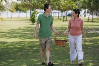 Mature couple in the park going for a picnic - Alex Mares-Manton