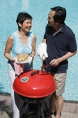 Mature couple having a barbeque - Alex Mares-Manton