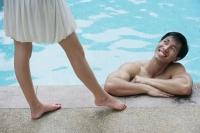 Man in pool looking up at woman - Alex Mares-Manton