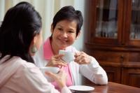 Mother and daughter enjoying tea together - Alex Mares-Manton