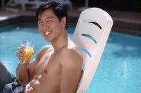Young man relaxing in deck chair by the pool - Cedric Lim