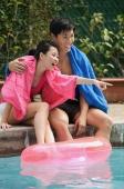 Young couple having fun at the pool - Cedric Lim
