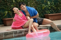 Young couple having fun at the pool - Cedric Lim