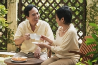 Mature couple having tea in the garden - Cedric Lim