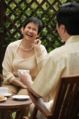 Mature couple laughing while having tea - Cedric Lim