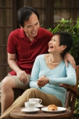 Mature couple laughing and looking at each other - Cedric Lim