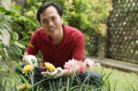 Man gardening and smiling at camera - Cedric Lim
