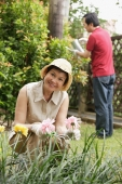 Mature couple gardening - Cedric Lim