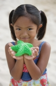 Girl with starfish smiling at camera - Yukmin