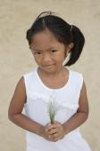 Young girl at beach looking at camera - Yukmin