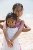 Sisters hugging at the beach - Yukmin