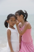 Girl whispering into sister's ear - Yukmin