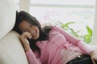 Young woman smiling at camera - Yukmin