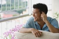 Young man talking on the phone - Yukmin