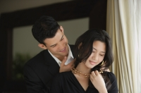 Man caressing woman's neck - Yukmin