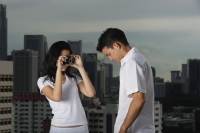 Woman taking picture of man - Yukmin