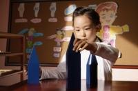 Schoolgirl with building blocks - Alex Mares-Manton