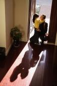 Girl greeting father at doorstep - Alex Mares-Manton