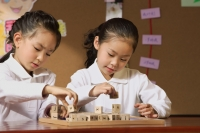 Schoolgirls in class playing with blocks - Alex Mares-Manton