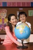 Schoolboy with teacher and globe - Alex Mares-Manton