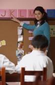 Teacher teaching alphabet in class - Alex Mares-Manton