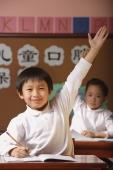 Students in class raising hands - Alex Mares-Manton