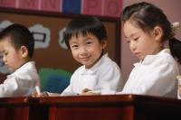 Students in class, schoolboy smiling at camera - Alex Mares-Manton