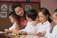 Young school children with their teacher - Alex Mares-Manton