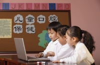 Young students using laptop in class - Alex Mares-Manton