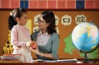Schoolgirl giving teacher an apple - Alex Mares-Manton